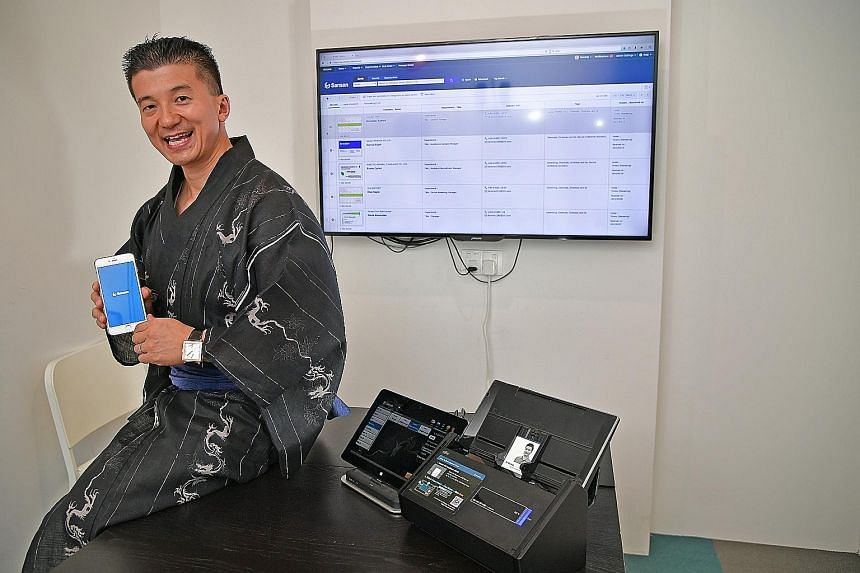 """Sansan's chief operating officer, Mr Rio Inaba, hopes that his company's business card information storage and retrieval service will one day become as ubiquitous in offices as a photocopy machine. """"Our system should be part of the basic business inf"""