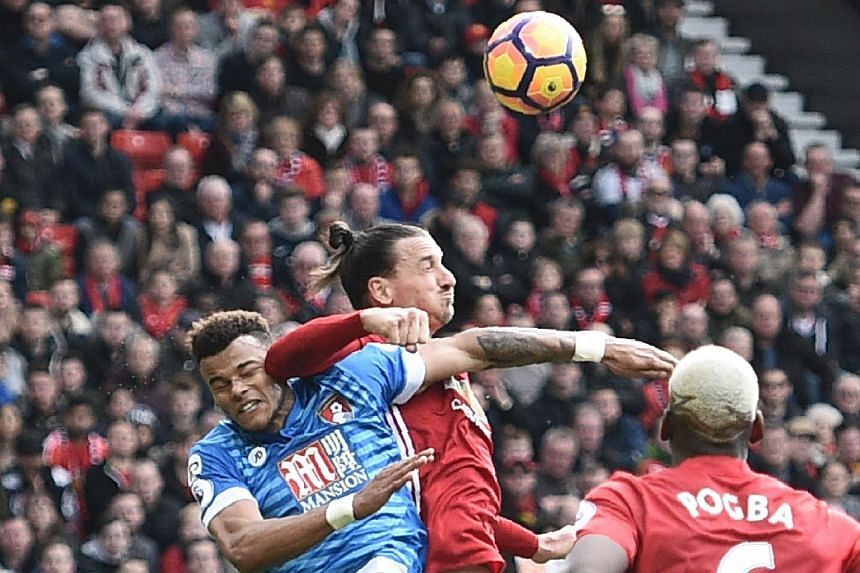 Manchester United forward Zlatan Ibrahimovic and Bournemouth defender Tyrone Mings fighting for the ball during their EPL match on March 4, 2017.