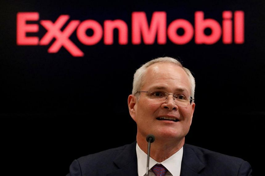 Darren Woods, Chairman & CEO of Exxon Mobil Corporation speaks during a news conference at the New York Stock Exchange.