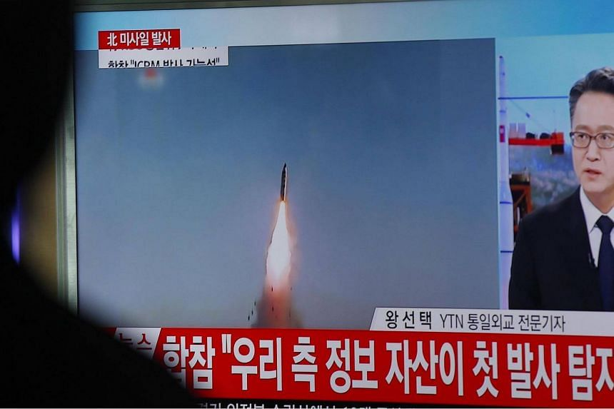 South Koreans watch a television displaying news broadcasts reporting on North Korea test-firing ballistic missiles, at a station in Seoul, South Korea.