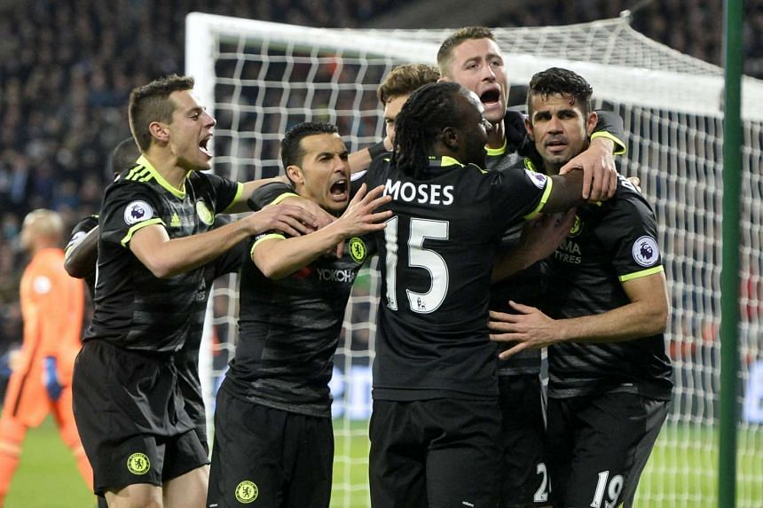 Chelsea's Diego Costa (right) celebrates with teammates after scoring the second goal against West Ham United on Monday (Mar 6, 2017).