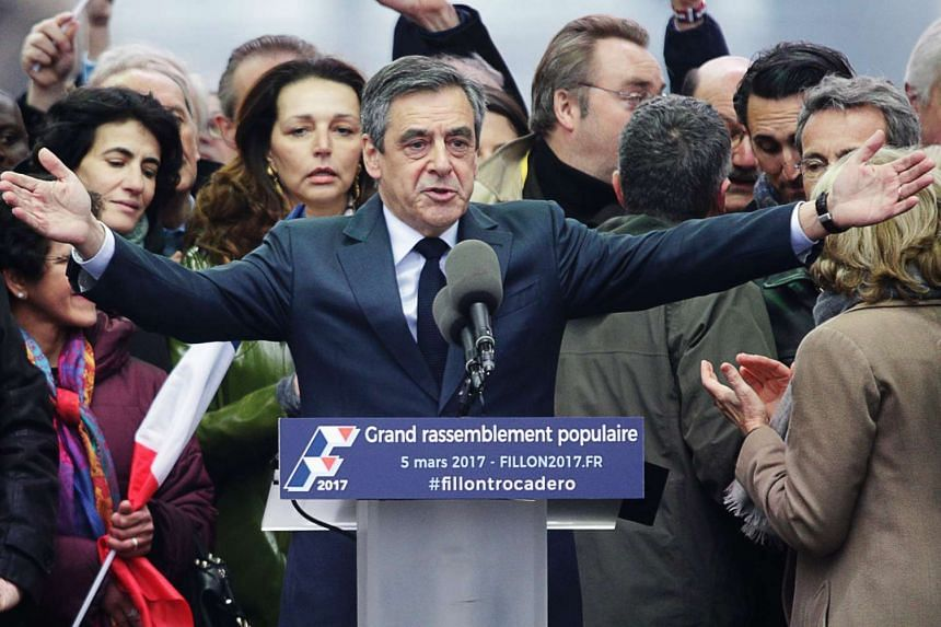 French presidential election candidate Francois Fillon (centre) gestures as he speaks at the place du Trocadero, in Paris, on Sunday (Mar 5, 2017).