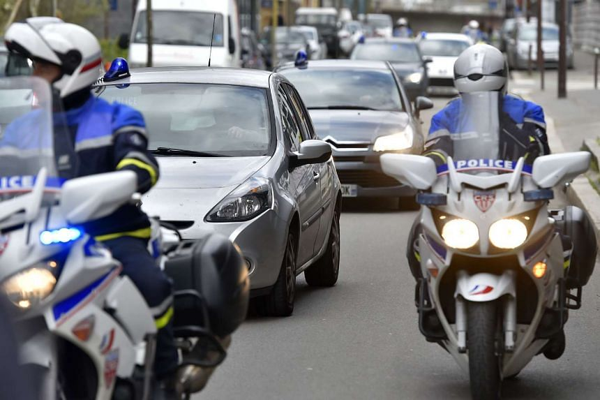 A police convoy transports two suspects in the murder of the French Troadec family to the Nantes courthouse on Monday (Mar 6, 2017).