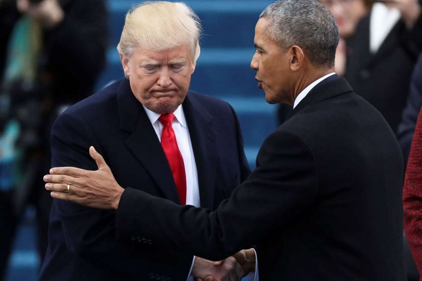 Outgoing US President Barack Obama greets incoming President Donald Trump at inauguration ceremonies swearing on Jan 20, 2017.