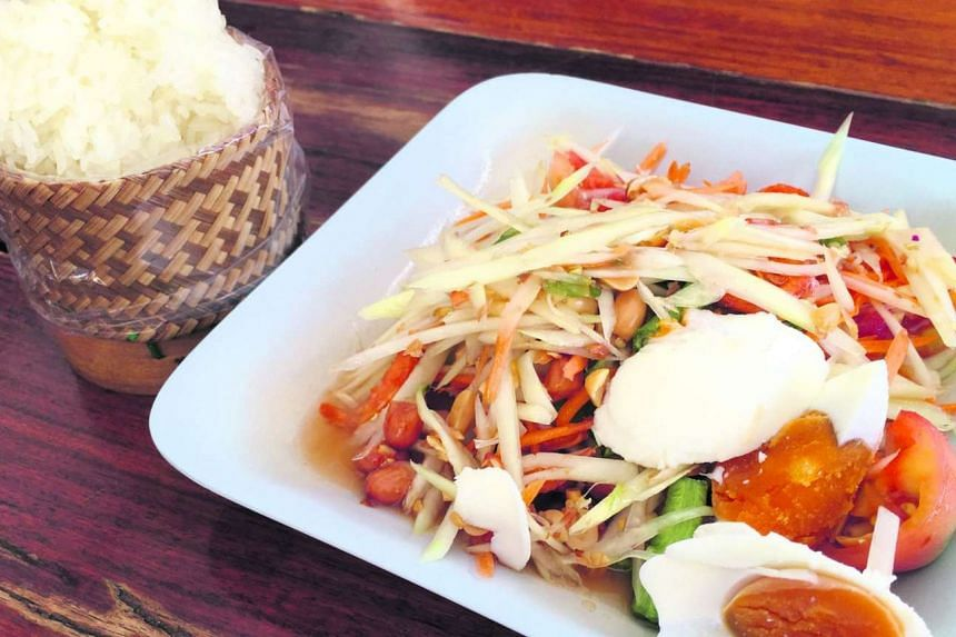 Sweet and sour green papaya salad with salted egg from Tum Nak.
