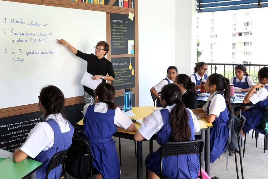 CHIJ St Theresa's Convent teacher, Ms Donna Koh, conducting an English lesson for Secondary 4 students.