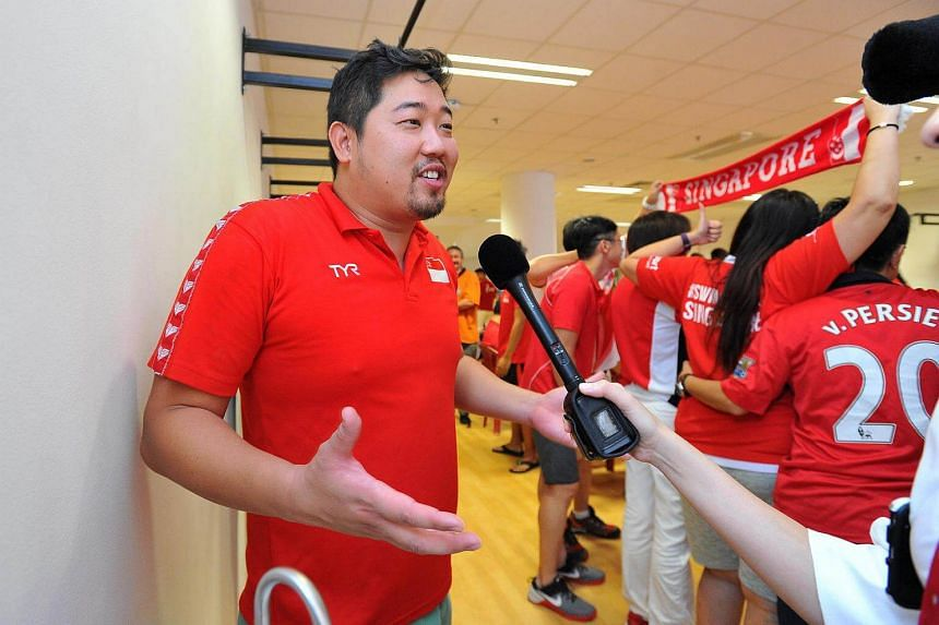 Assistant national swim coach Gary Tan at the OCBC Aquatic Centre during a screening of Joseph Schooling's 100m butterfly race at the Rio Olympics on Aug 13, 2016.