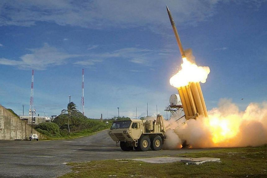 A Terminal High Altitude Area Defence (THAAD) interceptor is launched during a successful intercept test, in this undated handout photo provided by the US Department of Defence, Missile Defense Agency.