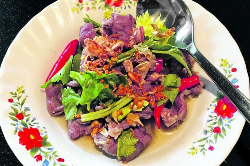Sliced marble beef tossed with spicy dressing and garnished with garlic from Supanniga Eating Room.