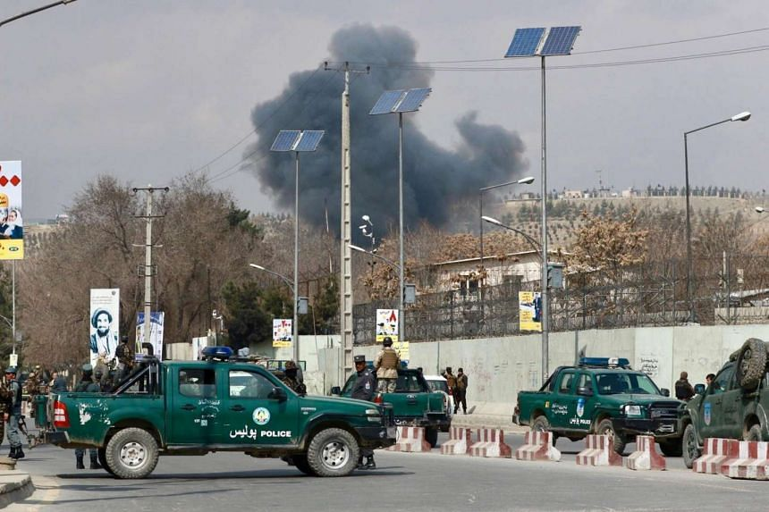 Smoke rising from the Kabul Military Hospital after militants attacked it, in Kabul, Afghanistan, on March 8, 2017.