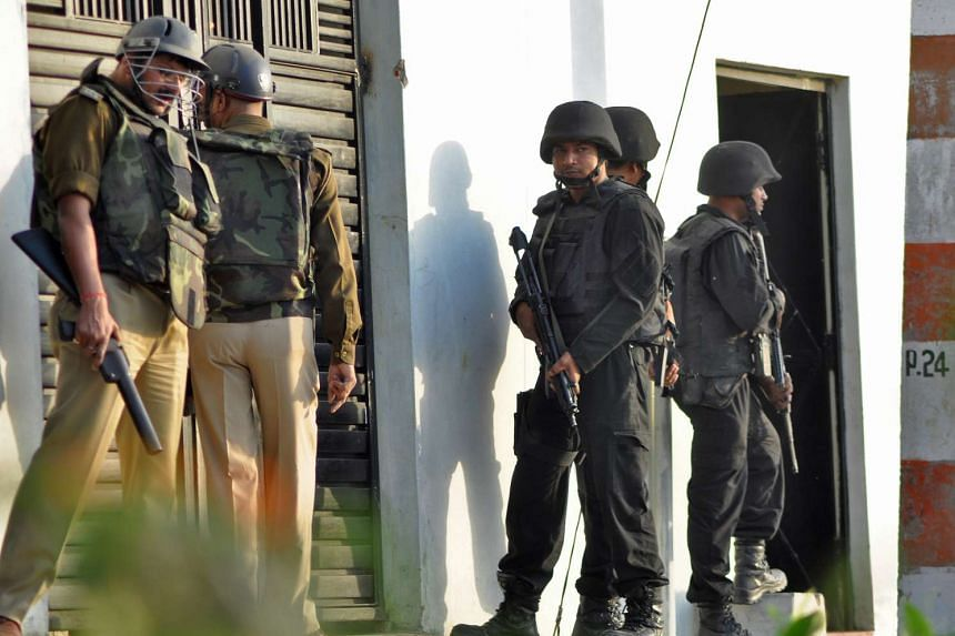 Anti Terrorist Squad (ATS) commandos and local police standing guard outside a house where a suspected militant is said to be hiding, in Lucknow, India, on March 7, 2017.