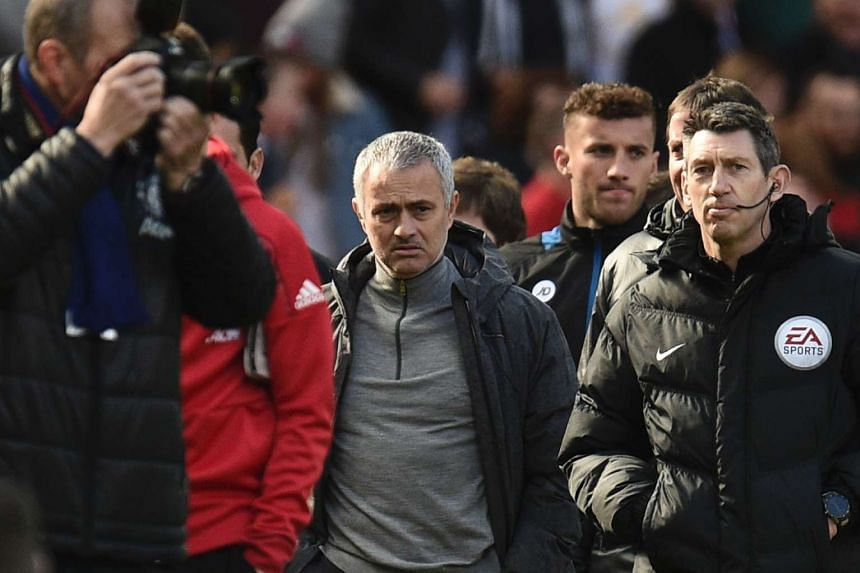 Mourinho (centre) arrives for a match against Bournemouth on March 4, 2017.