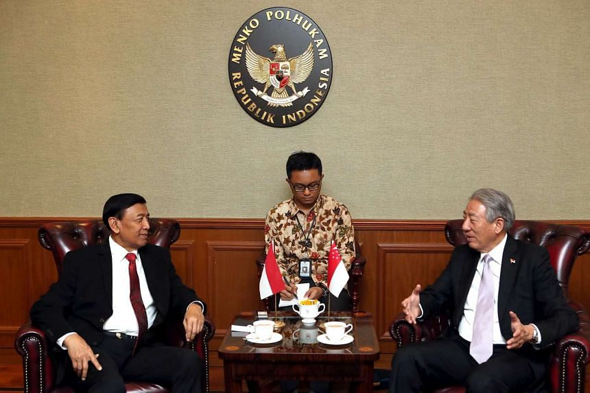 Singapore DPM Teo Chee Hean speaking with Indonesian Coordinating Minister for Political, Legal and Security Affairs Wiranto in Jakarta on March 8, 2017.
