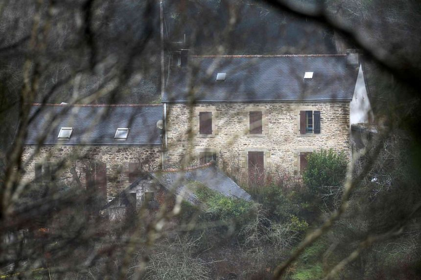 A March 7, 2017, photo in Pont-de-Buis, western France, shows a view of the house of Lydie Troadec, sister of Pascal Troadec who went missing with his wife and two children.