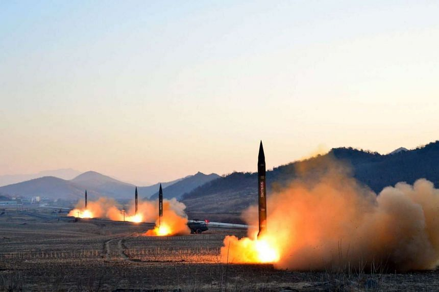 An undated photo released by North Korea's Korean Central News Agency showing the launch of four ballistic missiles by the Korean People's Army during a military drill at an undisclosed location in North Korea.