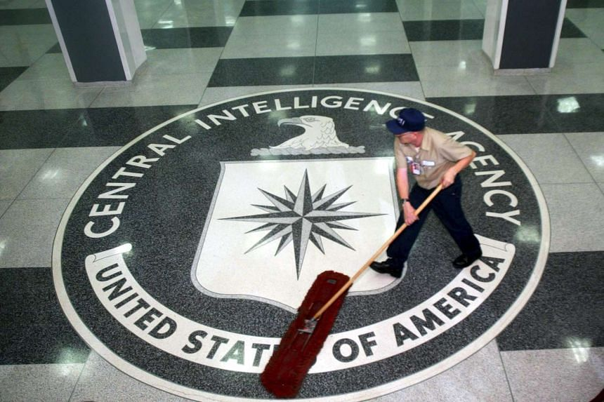A worker at the CIA sweeping the foyer clean at the CIA Headquarters, Langley, Virginia, USA, on March 3, 2005.