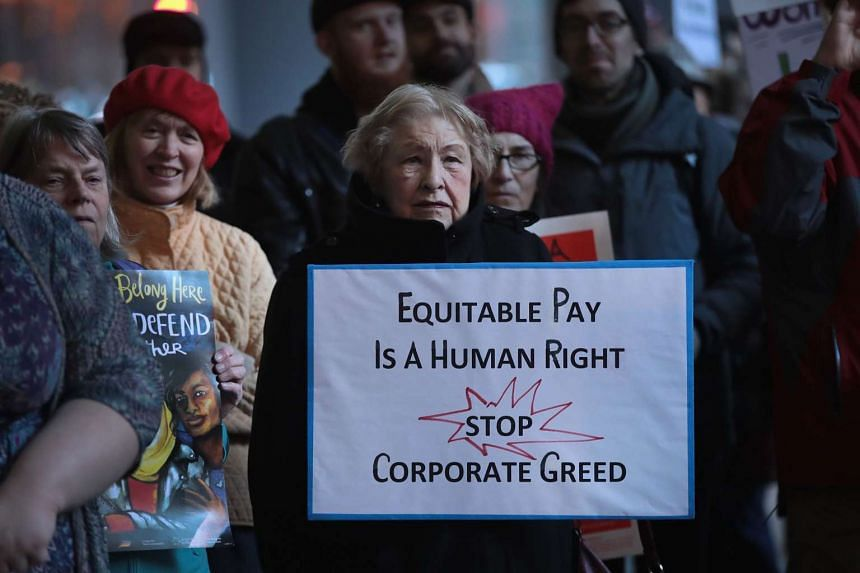 Demonstrators support International Women's Day and protest against the Trump administration on March 7, 2017, in Chicago, Illinois.