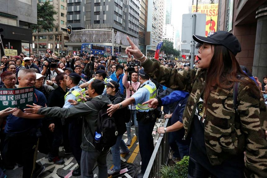 A pro-China activist arguing with protesters taking part in a pro-democracy march in Hong Kong on Jan 1, 2017.