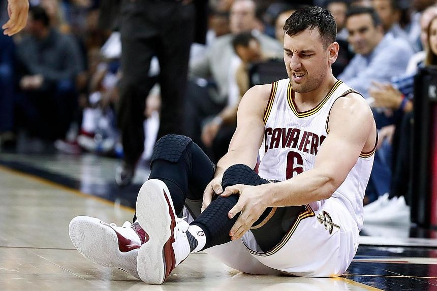 Andrew Bogut of the Cleveland Cavaliers after fracturing his left tibia in a collision with Miami Heat's Okaro White. Ironically, the veteran centre was signed as a free agent by the Cavs last week because of concerns over the champions' growing inju