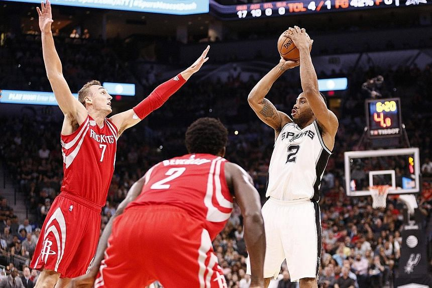 San Antonio's Kawhi Leonard shooting over Houston's Sam Dekker during the first half at AT&T Centre. The Spurs won the game 112-110 to record their eighth straight victory.