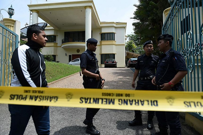 """Malaysian police guarding the North Korean Embassy in Kuala Lumpur yesterday. Following Pyongyang's move to prevent Malaysians from leaving North Korea, Mr Najib said he had instructed police to stop North Koreans from leaving Malaysia """"until we are"""