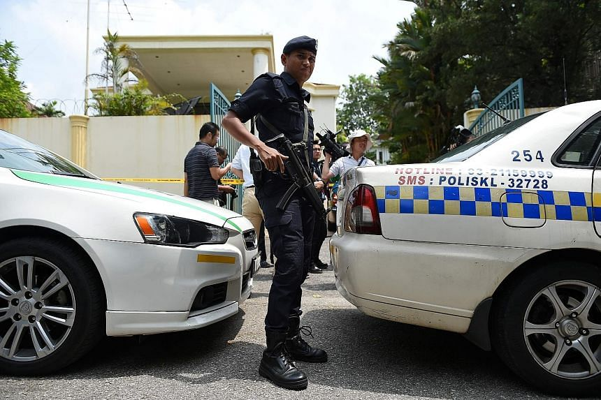 The North Korean Embassy cordoned off in Kuala Lumpur yesterday, with police stationed outside. Malaysia's move came after its own diplomats were prevented from leaving their embassy in Pyongyang.