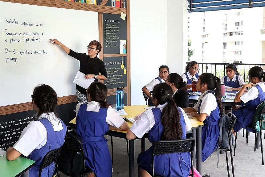 CHIJ St Theresa's Convent teacher Donna Koh conducting a Sec 4 English lesson in a class of N(A) and N(T) students.