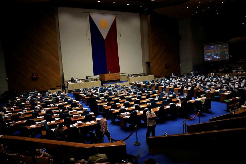 Members of the Philippine Congress attending the third and final reading of the death penalty bill inside the House of the Representatives in Quezon city, metro Manila, Philippines.