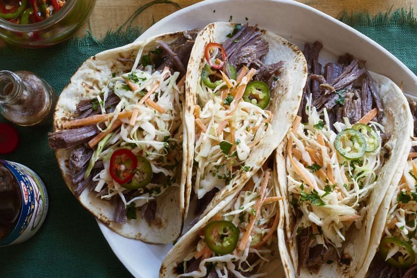 Irish tacos made with corned beef and cabbage slaw. For a large number of Americans, particularly Irish-Americans and particularly at this time of year, corned beef is a smell that signals the arrival of spring and the celebration of a culture unique