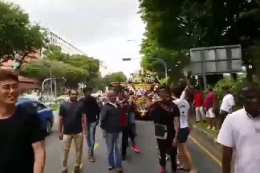 "A video posted by All Singapore Stuff on Facebook and credited to a reader ""Ma""', shows a big group of men repeatedly chanting ""Hai Lok San"" while walking down a road during a funeral procession."