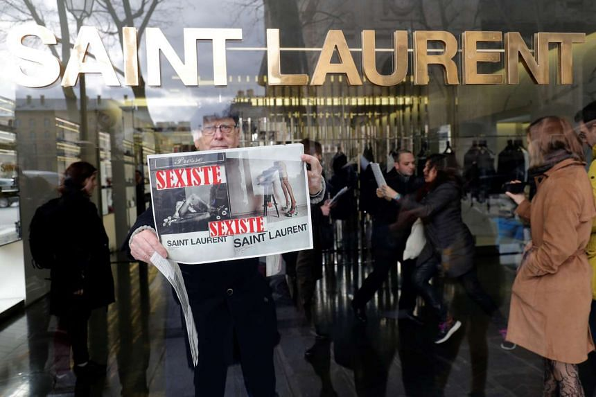 Activists holding a demonstration in front of a Yves Saint Laurent shop in Paris, France.