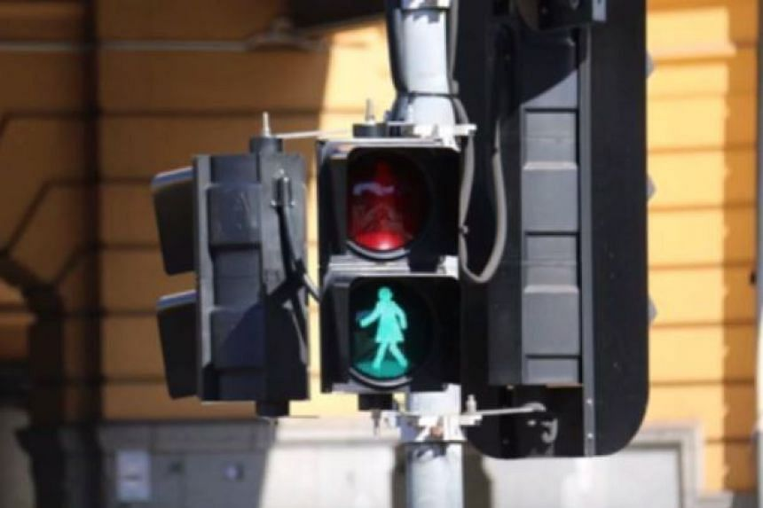 Traffic lights with women figures in Melbourne get mixed reactions.