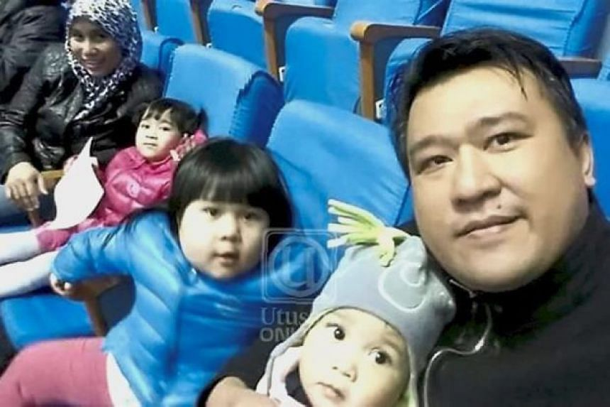 Mr Mohd Nor Azrin Md Zain taking a selfie with his wife and three children in Pyongyang.