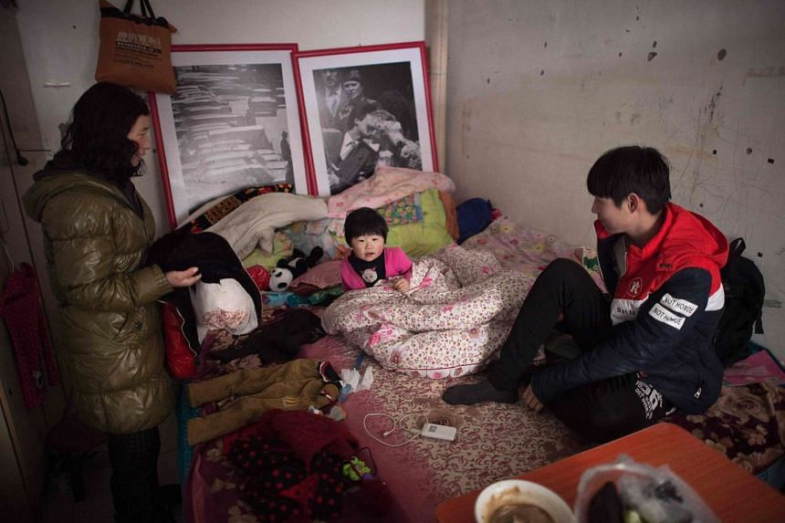 A family in their tiny shared room in the Heiqiaocun migrant village in Beijing. Since China began its campaign to fight economic inequality last year, 12.4 million people have been lifted out of poverty.
