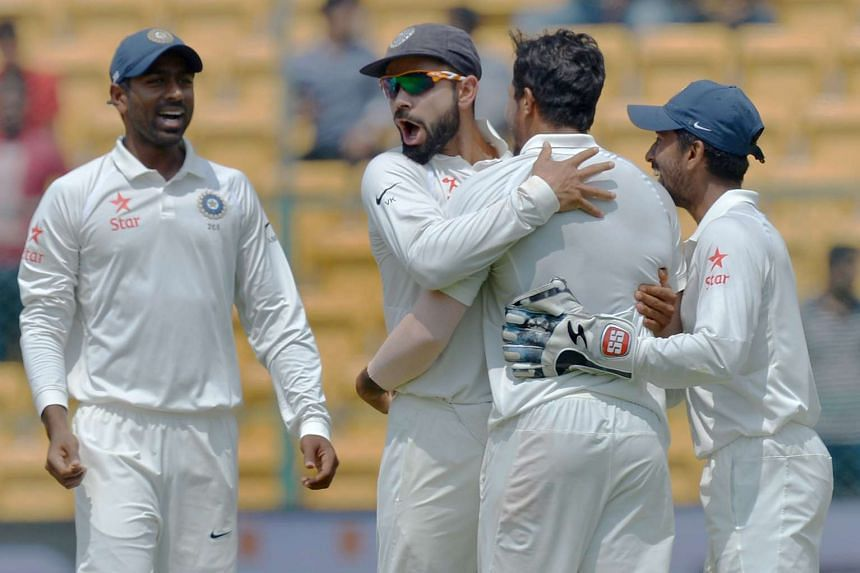 Indian skipper Virat Kohli (in sunglasses) celebrates with his teammates after the dismissal of Australian captain Steve Smith during the fourth day of the second Test match between India and Australia March 7.