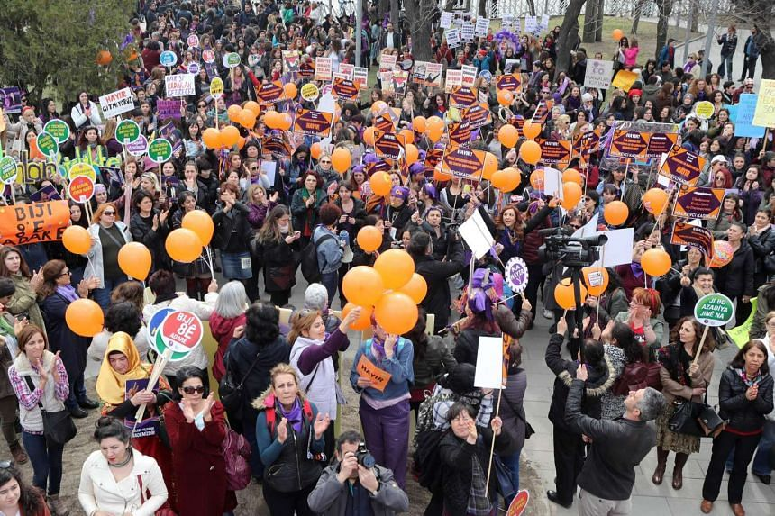 Women shouting slogans and holding banners as they demonstrate in central Ankara on International Women's Day.