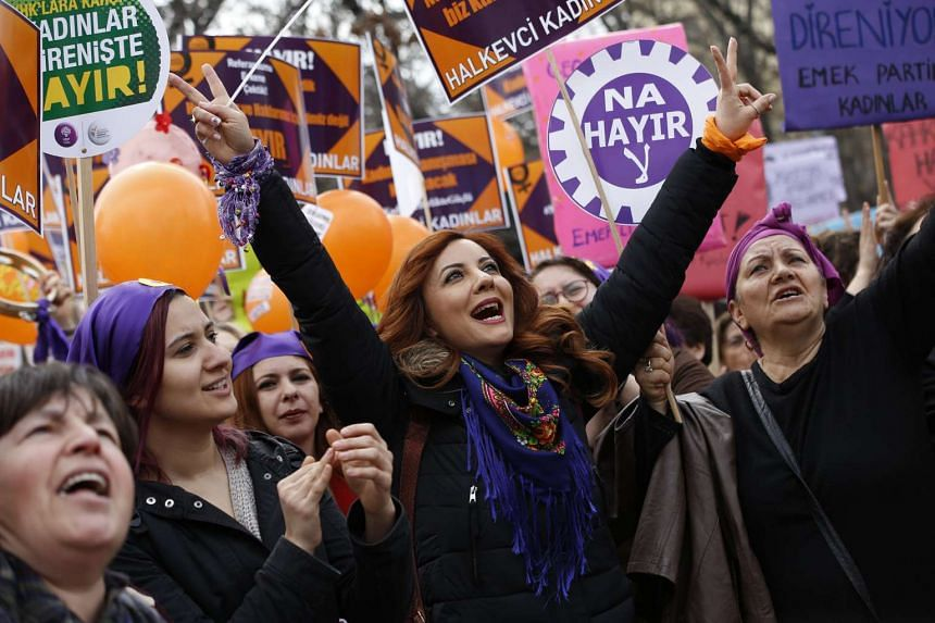 Women shouting slogans and holding placards against the upcoming referendum on the presidential reform during a rally on International Women's Day in Ankara, Turkey.