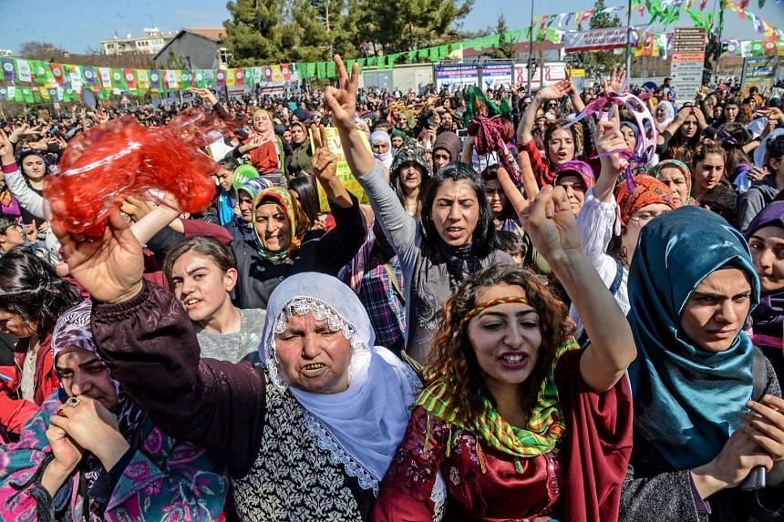 Women flashing victory signs during a demonstration as part of International Women's Day in Diyarbakir, Turkey.