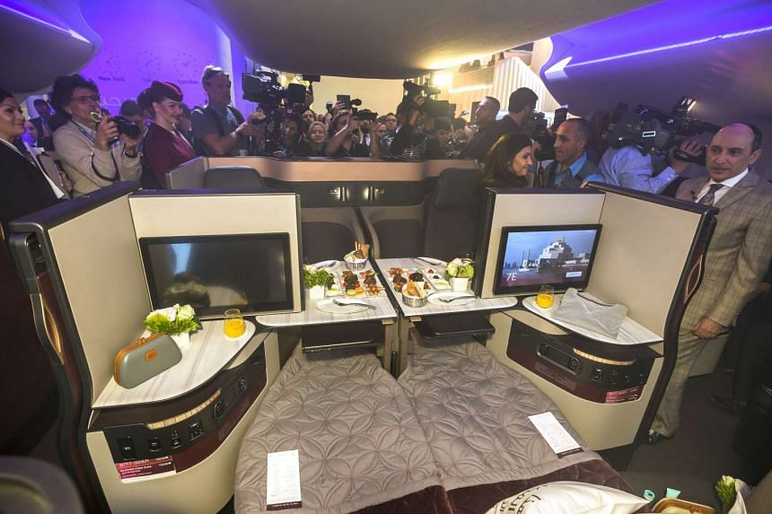Mr Akbar Al Baker, chief executive officer of Qatar Airways (far right), speaking to members of the media during the unveiling of the airline's new seating at the ITB Travel Fair in Berlin.
