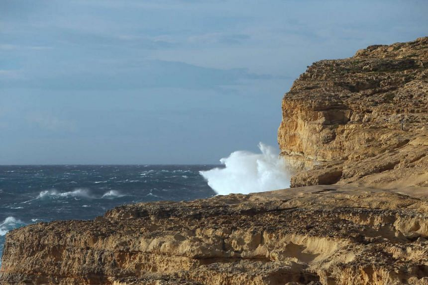 Waves break against the cliffs where the structure known as the Azure Window, because it arched over blue seas popular with divers, collapsed.