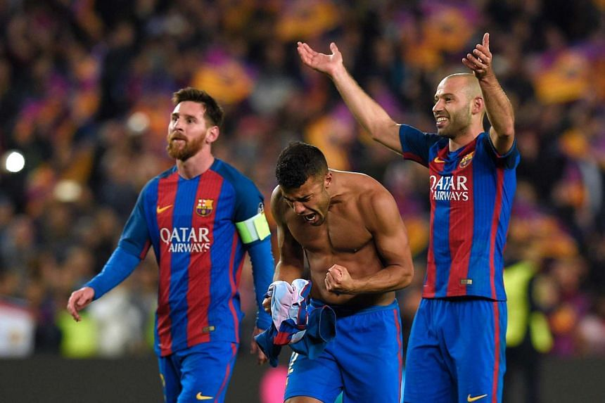 Barcelona's Lionel Messi (left), Rafinha (centre) and Javier Mascherano celebrate at the end of the match.