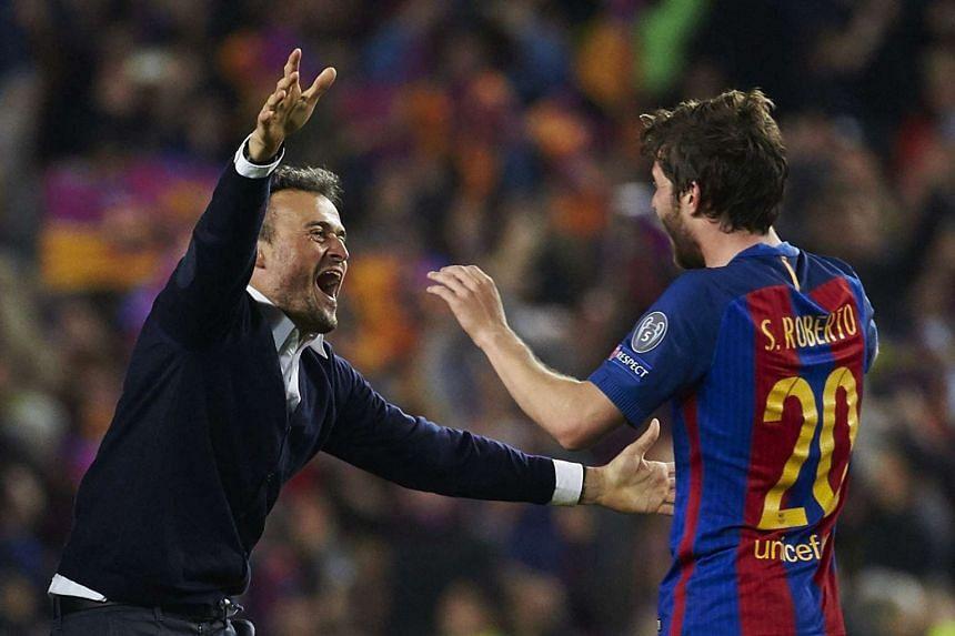 Barcelona coach Luis Enrique (left) and defender Sergi Roberto celebrate after the Uefa Champions League win against Paris Saint-Germain.