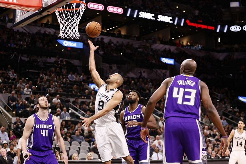 San Antonio Spurs point guard Tony Parker (9) shoots the ball against the Sacramento Kings during the first half at AT&T Center.