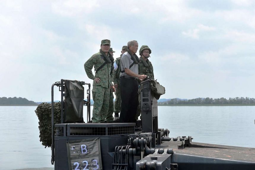 Defence Minister Ng Eng Hen (centre), accompanied by Chief of Army MG Ong (extreme left), piloting the M3G Raft across the Poyan Reservoir in the SAFTI Training Area.