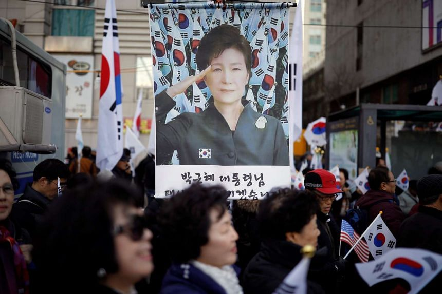 Supporters of South Korean President Park Geun-hye attend a protest near the Constitutional Court in Seoul.