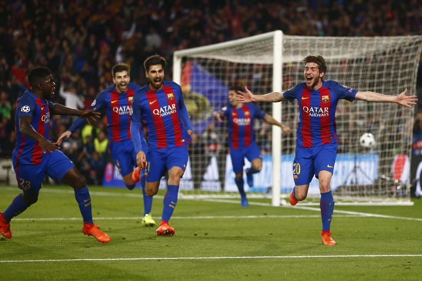 Barcelona players celebrating after scoring the sixth goal against Paris Saint-Germain during their Champions League match on March 8, 2017.