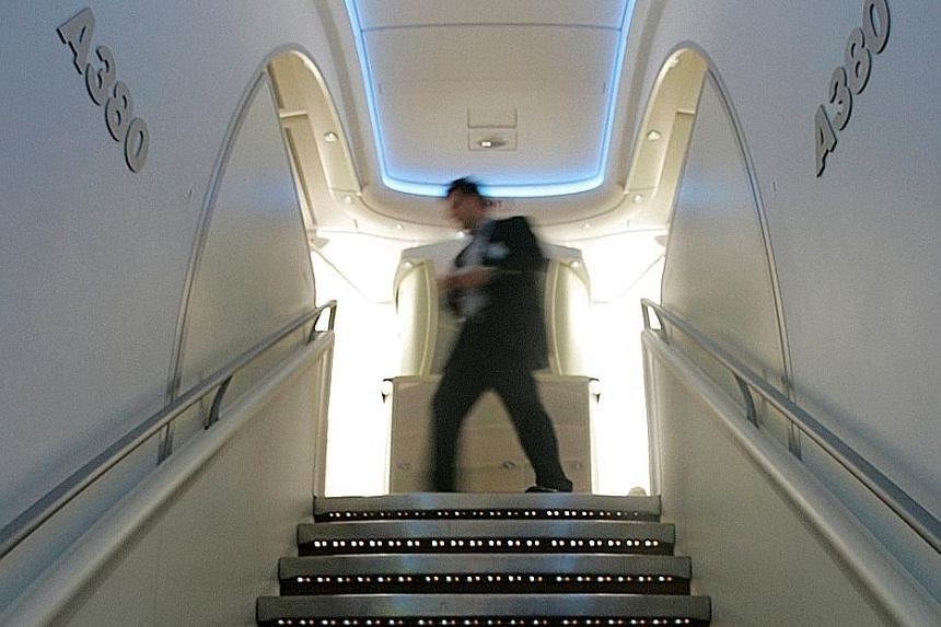 The A-380's sweeping, double staircase is one of the first features passengers see when boarding the plane.