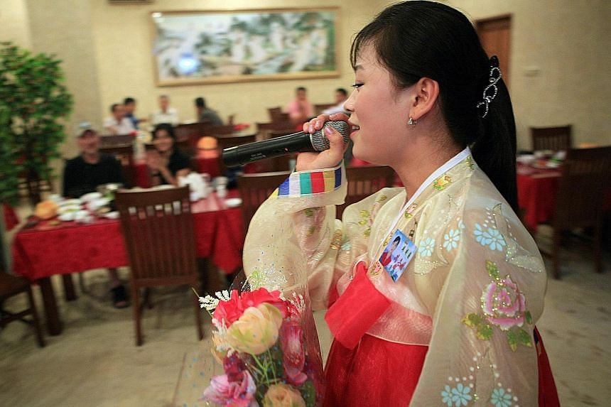 Customers in Jakarta, Indonesia listening to North Korean songs in a restaurant managed by Pyongyang to generate earnings overseas in this 2010 photo. North Korea has also ventured to other countries in Asean but its Friendship Restaurant (below) in