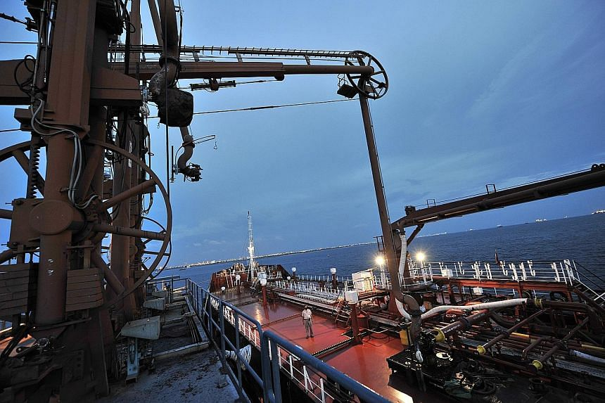 A tanker unloads fuel oil at a power station at a pier in western Singapore. With the International Maritime Organisation's 0.5 per cent cap on sulphur content for marine fuels taking effect in 2020, the shippping industry is expected to use marine g