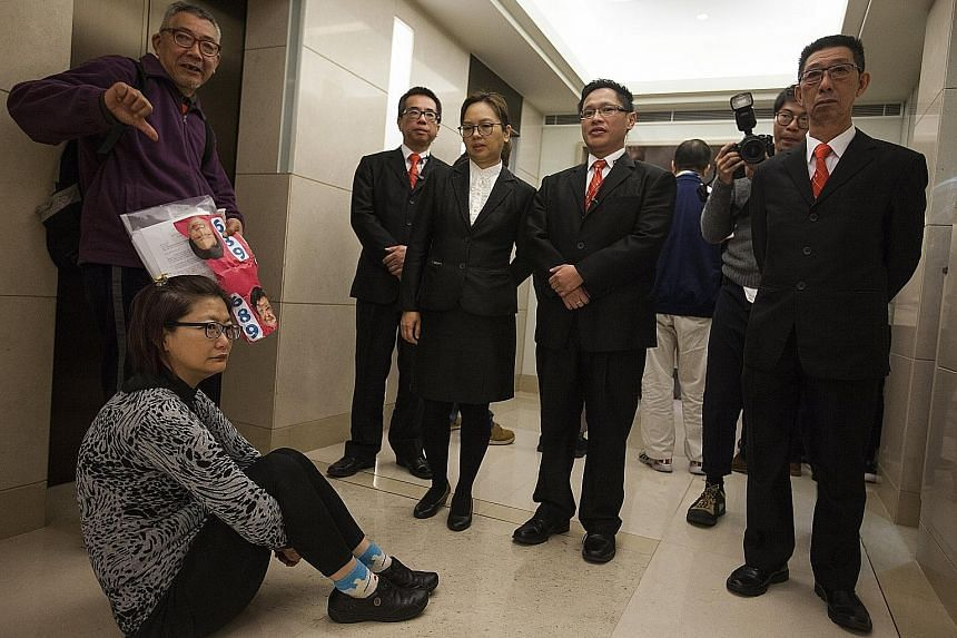 A pro-democracy sit-in during establishment candidate Carrie Lam's visit to the Electoral Affairs Commission last week. Some Hong Kongers object to the lack of universal suffrage in the election.